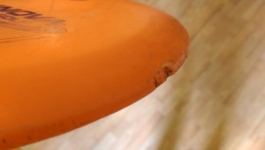 "This is an example of a ""worn"" disc with a rim gouge."
